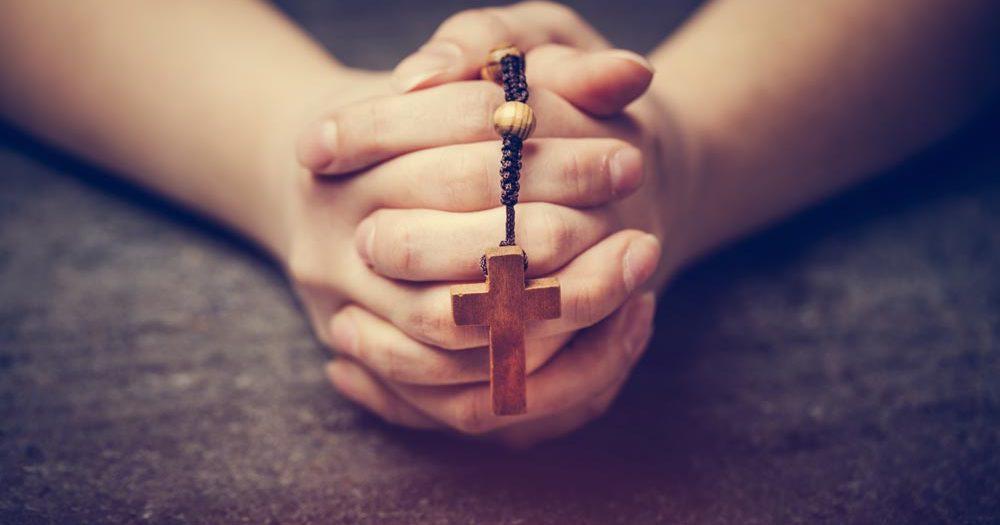Devotion Reflection. Person folding hands