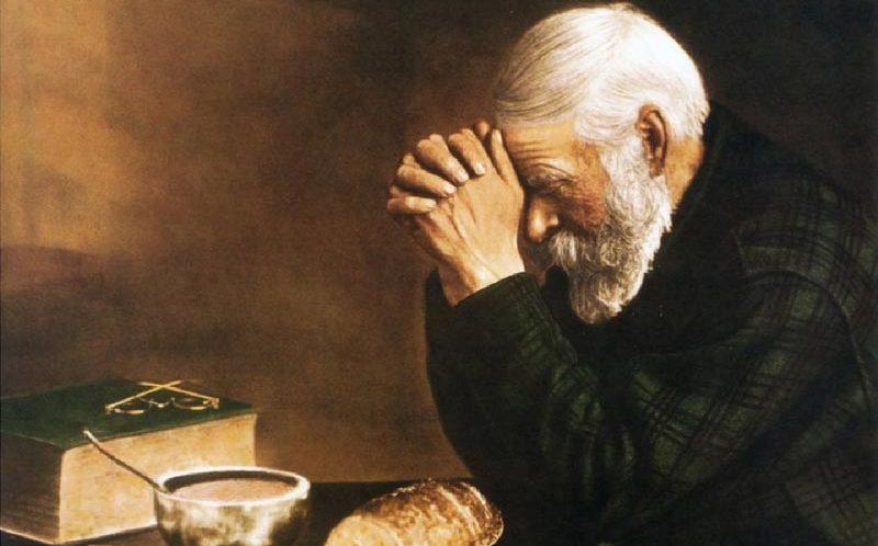 Unser tägliches Brot gib uns heute. Old Man Praying