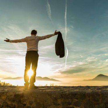 rear-view-of-successful-businessman-rejoice