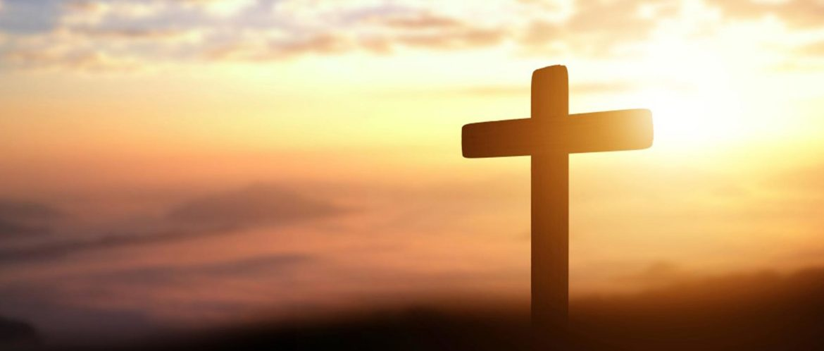 silhouette-of-catholic-cross-at-sunset-background-panorama-picture
